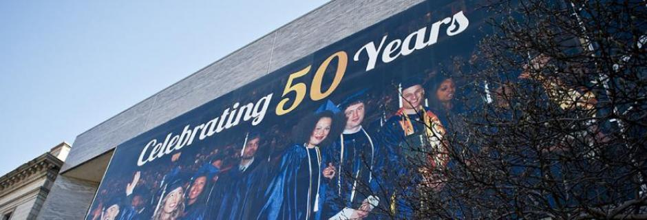 Large Banner on the West Building with the text Celebrating 50 years