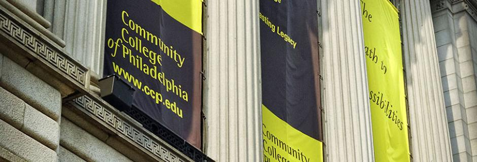 Banners hanging on Front of Mint Building with Community College of Philadelphia logo and www.ccp.edu.