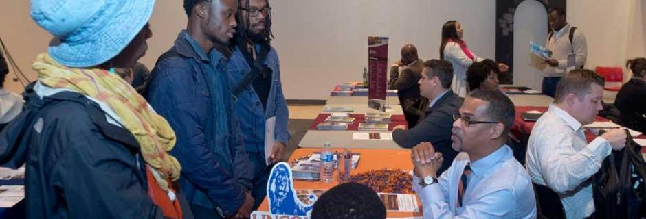 Transfer Fair - students talking to college rep from 4 year school
