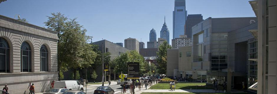 Campus looking down 17th Street with city skyline in the background