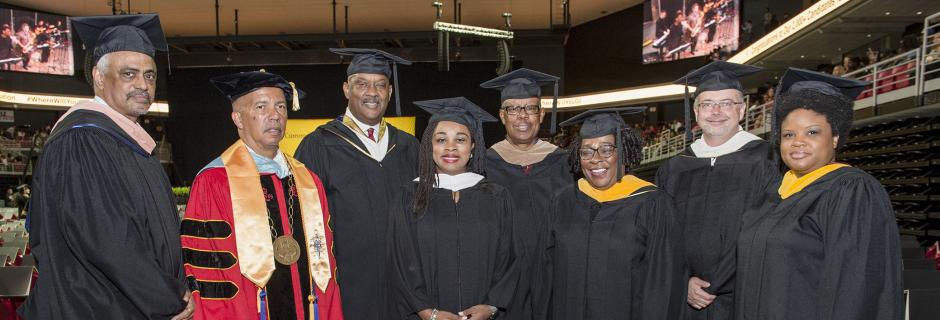 Dr generals and the board at graduation in commencement robes