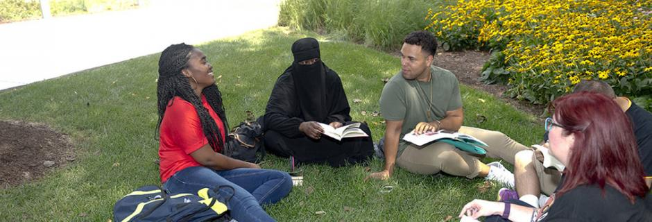 Students sitting on lawn at Community College of Philadelphia.