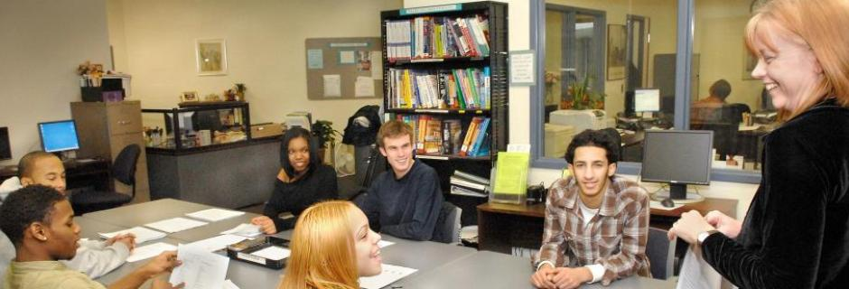 Students around table smiling