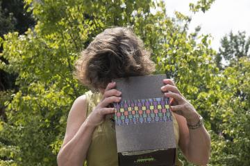 Faculty member views the eclipse through a homemade viewing box.