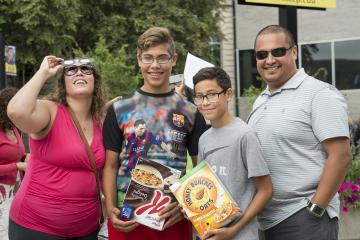 Staff member Angelica Aguirre and her family enjoy the eclipse party.