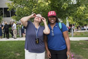 Two Eclipse Party Goers pose for the camera.