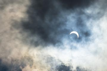 A view of the eclipse through the clouds.