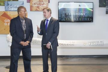 Dr. Generals speaks with the president of Harrisburg University, Dr. Eric Darr