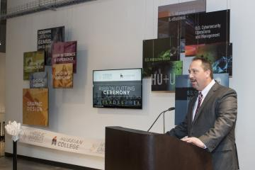 The president of Hussian College, Dr. Jeremiah Staropoli, speaks