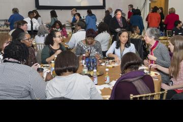Faculty and staff mingle and enjoy brunch
