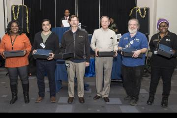 Employees with 30 years of service pose for the camera
