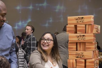Attendees play giant Jenga