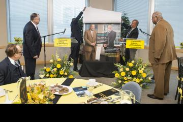 Patrick Clancy and Willie Johnson look on as Sulaiman Rahman and Dr. Generals reveal the magazine cover.