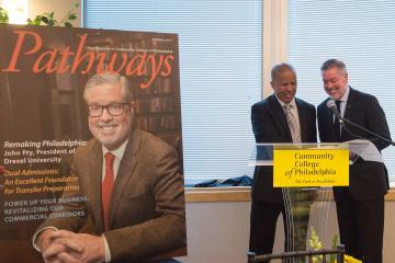 President Generals presents Drexel President Fry with his Pathways Magazine cover story.