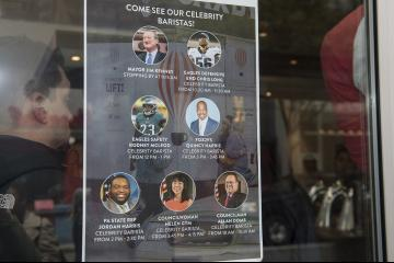 A window poster announces special guests of the event.