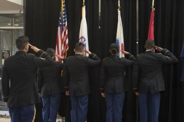 The Color Guard salutes the flags.