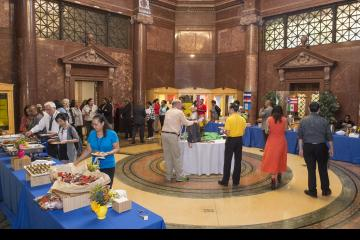 The crowd mingles and serves themselves lunch