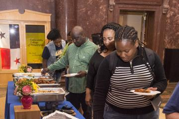 Attendees serve themselves lunch