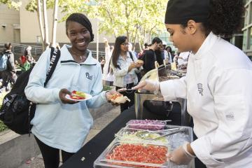 A happy student receives her Fiesta food.