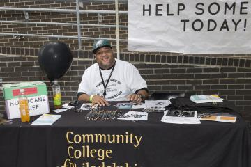 Student Body President Troy Bundy manned the Hurricane Relief table.