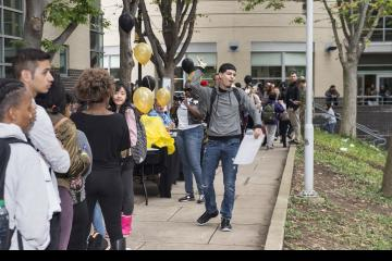 A student waiting in line enjoys the music filling Winnet Courtyard.