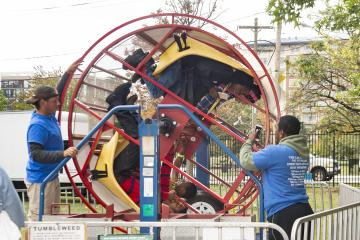 """Riders start to spin in the """"Tumbleweed"""" ride."""
