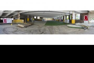 A panoramic view of the demolition party site before the party set up.