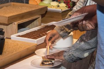 An attendee makes a s'more.