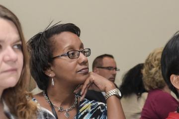 An audience member listens to Dr. Generals speech.