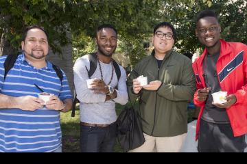 A group of fellows pose with their ice cream.