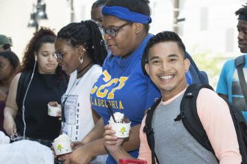A student poses with his ice cream.