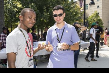 Two students pose with their ice cream.