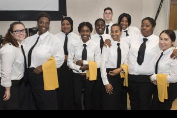 Hospitality Management Students, looking sharp, pose for the camera.