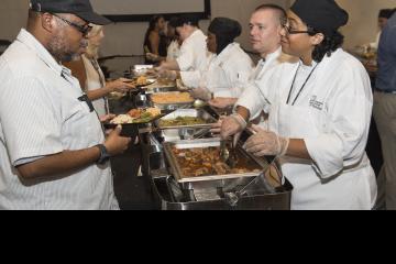 Culinary Arts students serving guests.
