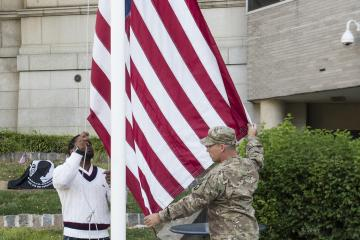 The Stars and Stripes are raised for the ceremony.