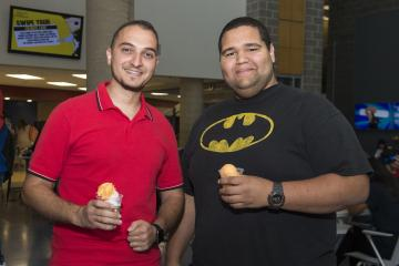 Two students pose with their water ice.