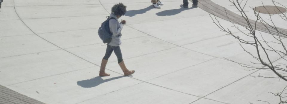 Student Walking Across Campus